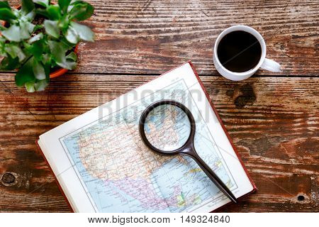 world map and coffee on wooden table time to travel top view