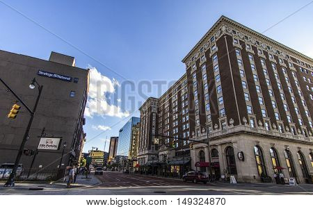 Grand Rapids, Michigan, USA - September 17, 2016: Monroe Street in downtown Grand Rapids with the historical Amway Grand Plaza Hotel in the foreground. Grand Rapids is one of  the largest cities in Michigan, second only to Detroit.