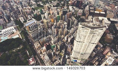 Top view aerial photo from drone of developed China city with tall skyscrapers and advanced transportation infrastructure. Office buildings in Hong Kong business district. Intelligent city background