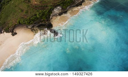 Aerial photo from flying drone of beautiful seascape with island with tropical plants near paradise beach with turquoise water. Copy space for advertising text message. Perfect background for website