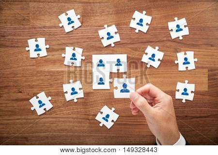 Assemble a team - business team, human resources, cooperation and unity concepts. Good team fit together like puzzle pieces.