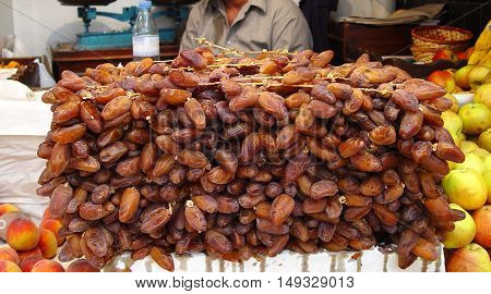 Tunisian dates on the branches stacked wall at the local bazaar
