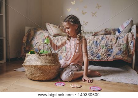 little child girl playing in her room with toy food cooking and having fun at home