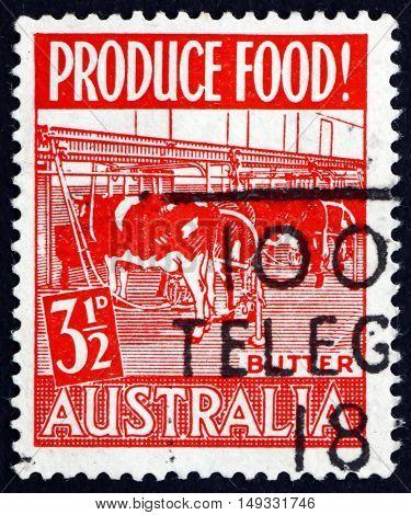 AUSTRALIA - CIRCA 1953: a stamp printed in Australia shows Modern Dairy Butter Production circa 1953