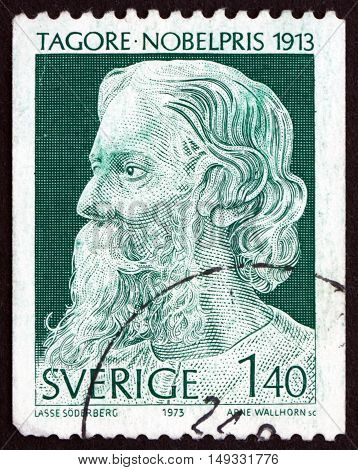 SWEDEN - CIRCA 1973: a stamp printed in Sweden shows Rabindranath Tagore Writer and Painter Winner of 1913 Nobel Prize circa 1973