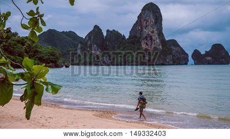 Lonely Traveler on Railay Beach in Krabi, Thailand. Asia