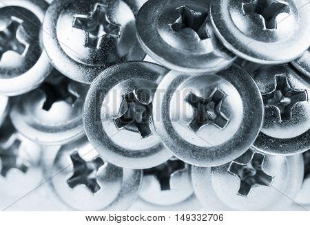Many Silver Screw Heads Toned Grey