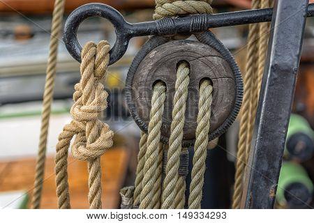 Old rope on sailing boat closeup photo