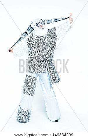 One cheerful female clown dressed in black and white cloth on a white background