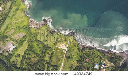Top view aerial photo from flying drone of a wonderful nature landscape on green tropical island. Seashore with turquoise water as the perfect place for a calm summer vacation.Beautiful Asian seascape