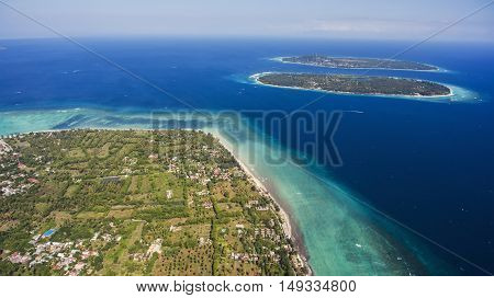 Aerial drone photo of Gili Islands with incredible diversity of marine life from migrating whales to colourful intertidal creatures offers a truly unforgettable experience during vacations holidays