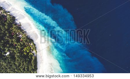 Top view aerial drone photo of unspoiled deserted powder-white sandy seashore with crystalline water. One of the most beautiful beaches in the world for travel website or journey blog background