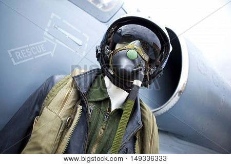 Uniform bomber on a plastic mannequin in front of a fighter