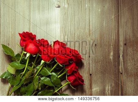 Dozen Red Roses on Wood Background / Proposal/ top view, copy space, toning