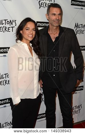 LOS ANGELES - SEP 27:  Michelle Rodriguez, Barnet Bain at the