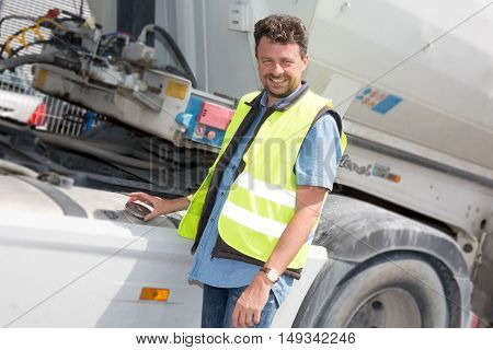 Confident Driver Or Forwarder In Front Of Trucks And Trailers,