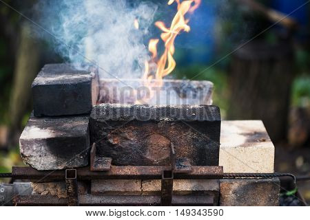 Flame In Outdoor Rural Brick Forging Furnace