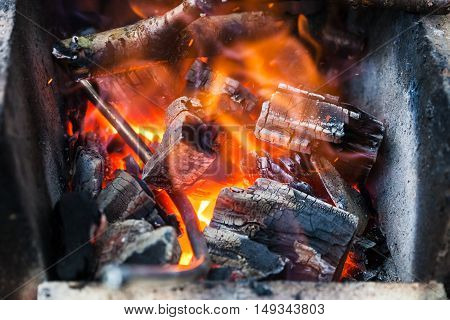 Iron Rod Is Heated In Burning Wooden Coals