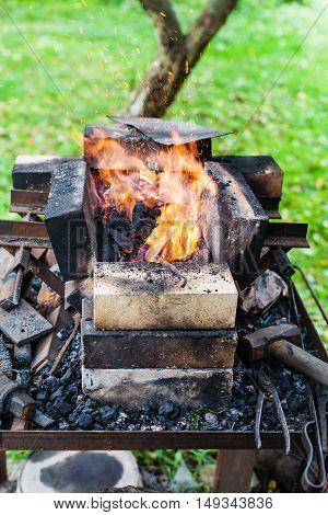 Steel Rod Is Heated In Rural Forging Furnace