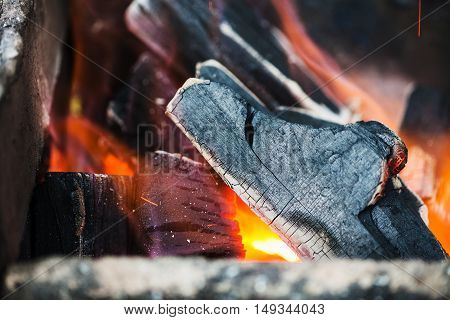 burning wooden coals in the forge furnace close up