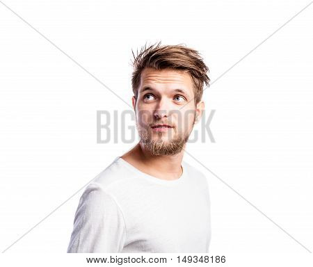Hipster man in white long-sleeved t-shirt, studio shot on white background, isolated