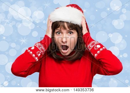 Christmas stress - busy woman wearing santa hat stressing for christmas shopping. Funny image of shouting santa girl on holiday background.
