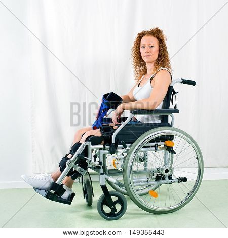 Serious Woman In Wheelchair Looks At Camera