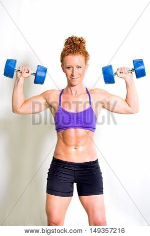 Strong Muscular Young Woman Lifting Weights
