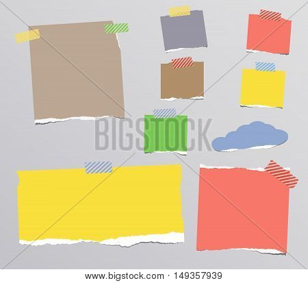 Ripped colorful notebook, note paper stuck on gray background.