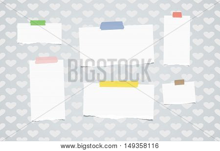 Ripped white notebook, note paper stuck with colorful sticky tape on pattern created of heart shapes.