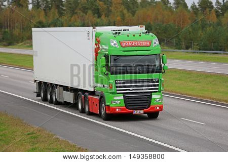 PAIMIO FINLAND - SEPTEMBER 23 2016: Lime green DAF XF reefer truck of Braunstein moving along freeway in South of Finland.