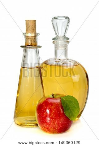 Apple Cider Vinegar In A Glass Vessel And Red Apple