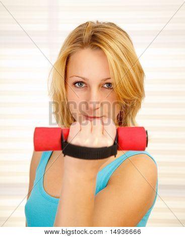 Girl Lifting Dumbbell