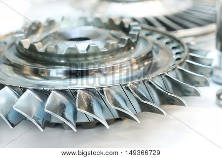 Wheel of the air compressor of an aircraft engine. Replacement of the jet engine.Turbine blades closeup. Shallow depth of field.