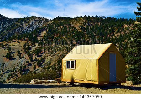 Modern rustic style tent cabin where people can enjoy a comfortable camping experience taken in Mt Baldy, CA