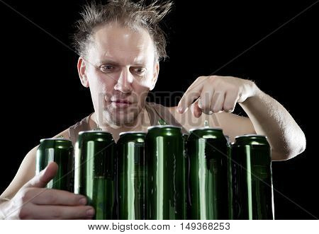 Hangover.The drunk man and is a lot of empty beer cans