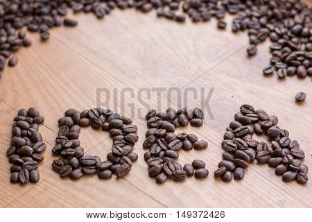 Idea concept sign drawn among brown well roasted coffee beans