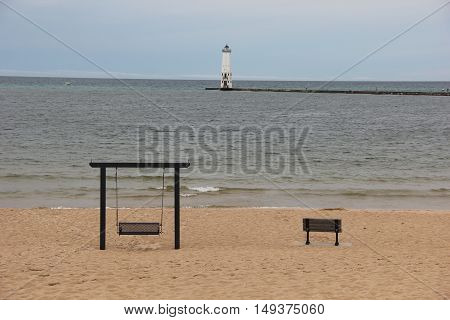 Swing and bench on the beach in Frankfort, Michigan