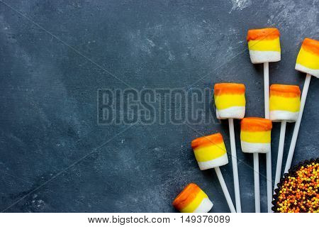 Candy corn marshmallow pops Halloween food recipe background blank space for text