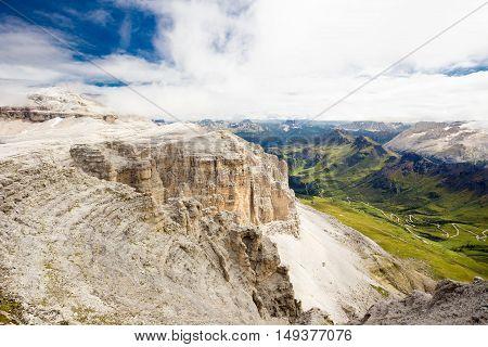 Pordoi pass mountain road valley and Piz Boe seen from the Sass Pordoi plateau in Dolomites Italy Europe