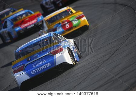 Loudon, NH - Sep 25, 2016: Carl Edwards (19) battles for position during the Bad Boy Off Road 300 at the New Hampshire Motor Speedway in Loudon, NH.