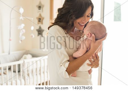 Mother With Baby In Arms