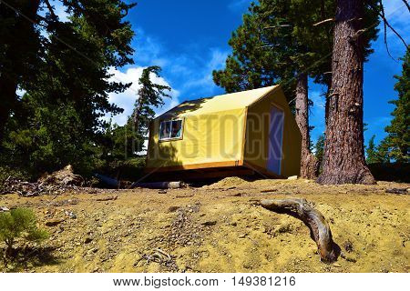 Modern rustic style tent cabin for a comfortable camping experience taken at a forest in Mt Baldy, CA