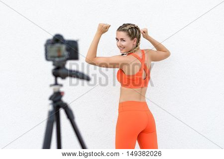 Young Fitness Blogger Taking A Selfie Video