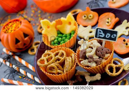 Various treats on Halloween party funny and healthy snacks for kids selective focus