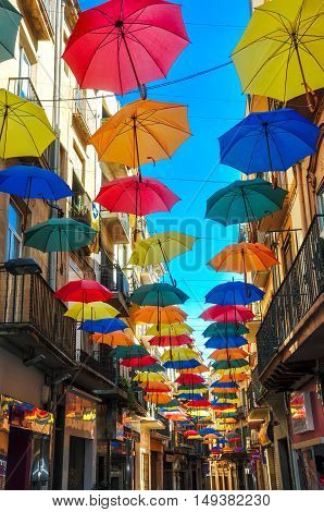 Antique Street Decorated With Bright Umbrellas.