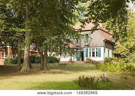 Hiddensee, Germany - September 19, 2016: Former summer house of German writer Gerhart Hauptmann at Kloster, Hiddensee island. Today the mansion serves as a museum for the famous novelist.
