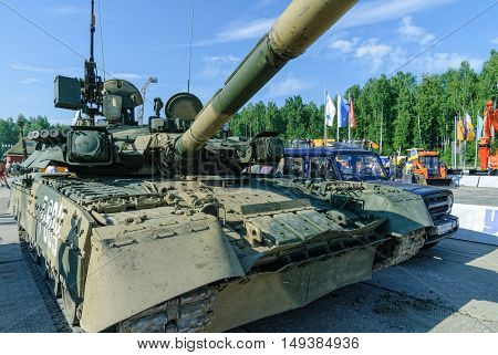 Nizhniy Tagil, Russia - July 12. 2008: Visitors examine military equipment on exhibition range. T80U modernized tank. Russian Arms Expo