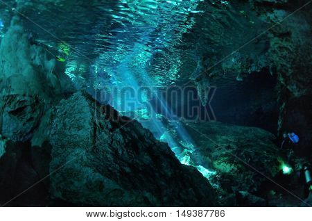 Reflection of sunrays and rocks on a water surface, Dos ojos cave, Yucatan peninsula, Mexico