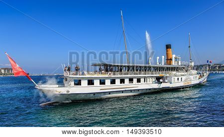 Geneva, Switzerland - 24 September, 2016: view on Lake Geneva with MS Savoie passing with people on board. Lake Geneva is a lake on the north side of the Alps, shared between Switzerland and France.